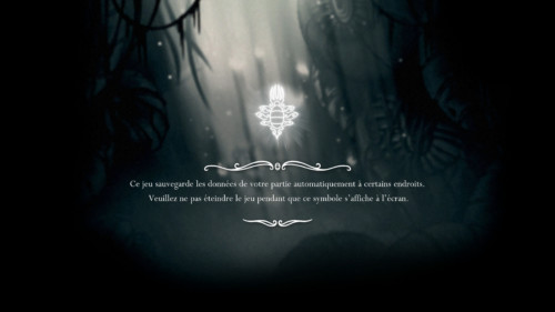 Loading screenshot of Hollow Knight video game interface.