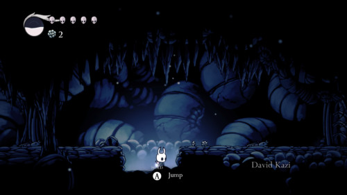 Tutorial screenshot of Hollow Knight video game interface.